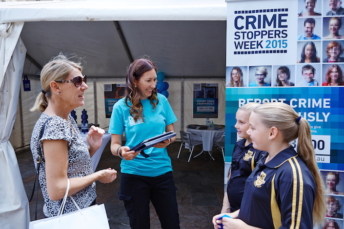 Active in the community: Crime Stoppers Operations Officer Julie Gorman explains to members of the public how they can report suspicious behaviour.